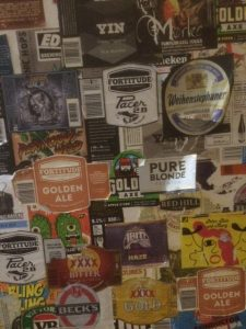 Beer labels on the way to the gents at the Embassy Hotel